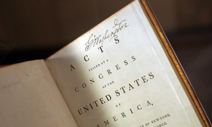 George Washington's personally annotated copy of the Acts of Congress is displayed on the 225th anniversary of the signing of the U.S. Constitution during an unveiling ceremony in Mount Vernon, Va., on Sept. 17, 2012. The rare volume includes Washington's personal copy of the Constitution. (Win McNamee/Getty Images)