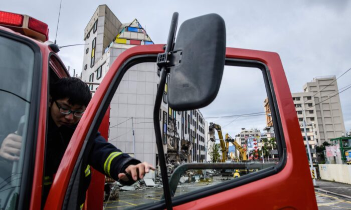 A fireman steps out of his firetruck in the Taiwanese city of Hualien on Feb. 9, 2018. (ANTHONY WALLACE/AFP via Getty Images)