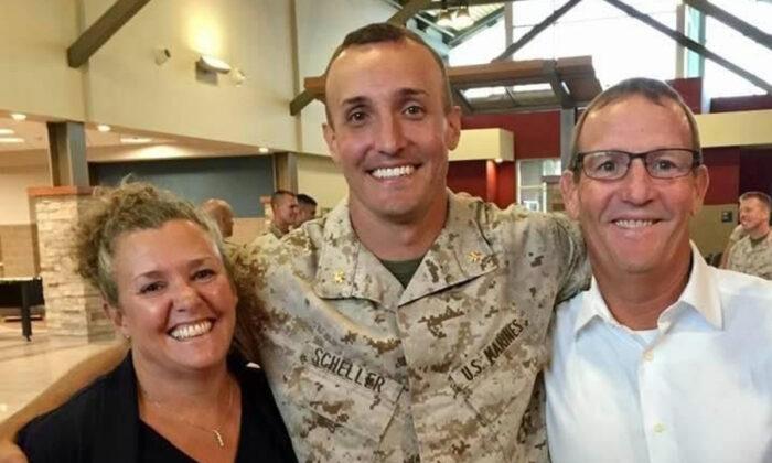 Lt. Col. Stuart Scheller (C) and his parents in a file photograph. (Courtesy of Stuart Scheller)