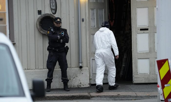 Police work near a site after a man killed several people, in Kongsberg, Norway, on Oct. 14, 2021. (Terje Bendiksby/NTB via AP)