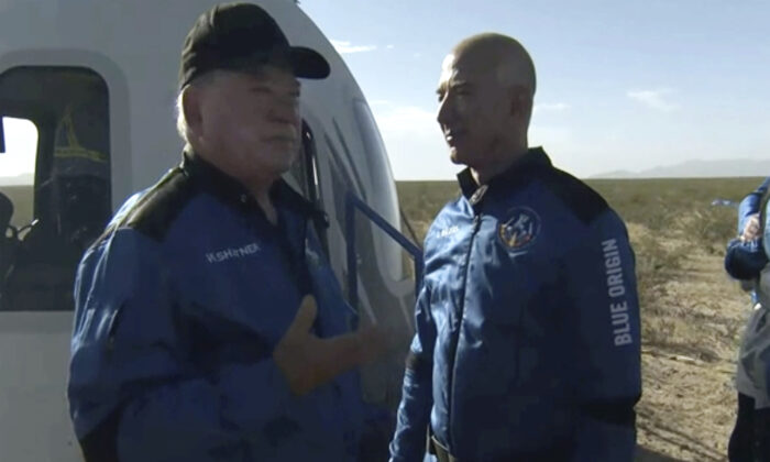 William Shatner talks with Jeff Bezos about his experience after exiting the Blue Origin capsule near Van Horn, Texas, on Oct. 13, 2021. (Blue Origin via AP)