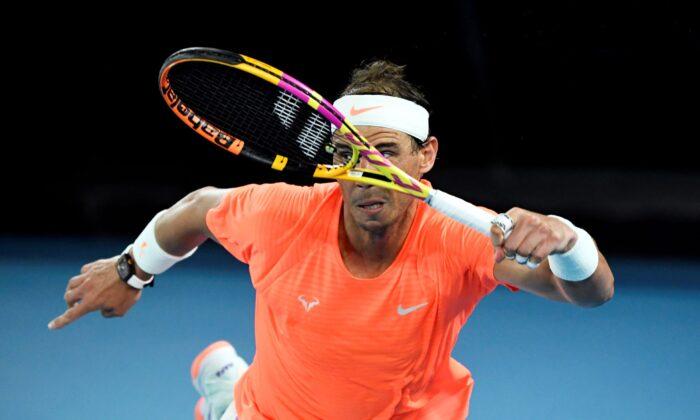 Rafael Nadal in action during his quarter final match against Greece's Stefanos Tsitsipas at Australian Open in  Melbourne Park, Australia, on Febr. 17, 2021. (Jaimi Joy/Reuters)