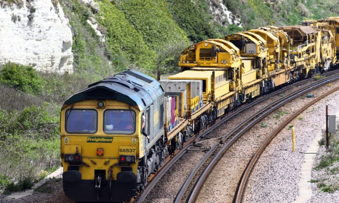 A Freightliner freight train, part of the Freightliner Group, passes through Dover in Kent, England, on April 26, 2019. (Gareth Fuller/PA Wire)
