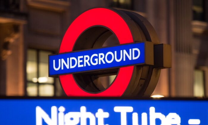 A London Underground roundel alongside an advert for the night tube at Oxford Circus underground station, in London on Aug. 17, 2016. (Dominic Lipinski/PA)