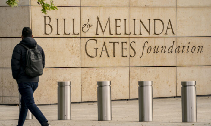 A pedestrian walks by the Bill & Melinda Gates Foundation in Seattle, Wash., on May 4, 2021. (David Ryder/Getty Images)