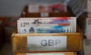 UK Borrowing Down by Half as Sunak Readies Budget