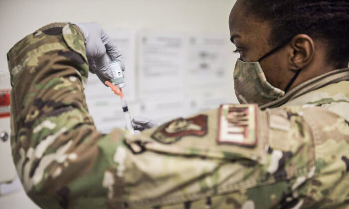KUNSAN, SOUTH KOREA - DECEMBER 29: (EDITORIAL USE ONLY) In this handout image provided by United States Forces Korea, U.S. Air Force Technical Sgt. Alexisa Humphrey prepares to administer the Moderna COVID-19 vaccine at Kunsan Air Base on December 29, 2020 in Kunsan, South Korea. United States Forces Korea (USFK) received the first shipment of Moderna's vaccine as Camp Humphreys was chosen by the U.S. government as one of four sites outside the continental U.S. that will receive the initial vaccination. (Photo by United States Forces Korea via Getty Images)