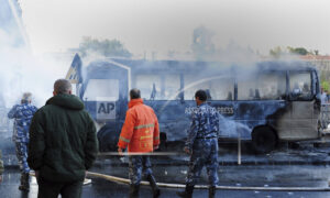 Bus Bomb Explodes in Syrian Capital Killing 14, Army Shelling in Rebel Territory Claims 12 Lives