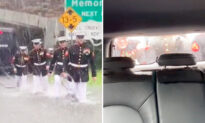 Video: Stranded Woman Films Uniformed Marines Pushing Her Car Out of Flood Waters