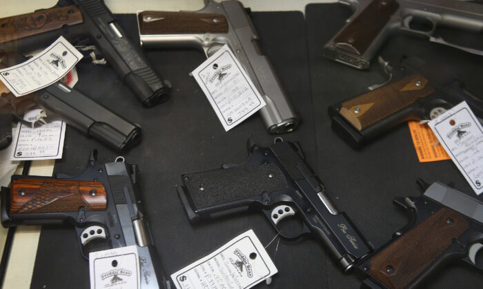 Pistols are offered for sale at Freddie Bear Sports in Tinley Park, Illinois, on Oct. 18, 2012. (Scott Olson/Getty Images)