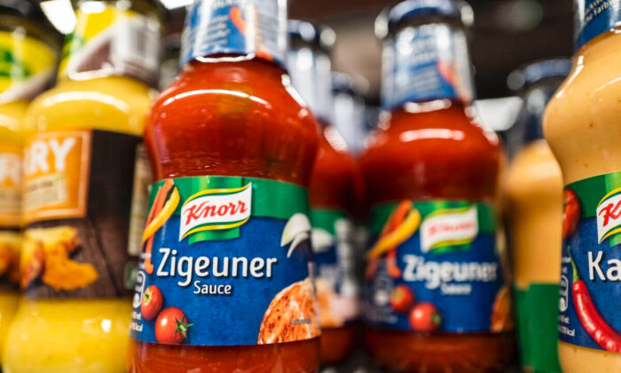 """Bottles of """"Zigeuner Sauce"""" (Gipsy Sauce) by German food maker Knorr are on display at a supermarket in Berlin on August 17, 2020. - German food maker Knorr said Monday it would change the name of its popular """"gypsy sauce"""" to something less offensive, becoming the latest global company to respond to complaints about racist branding. The so-called """"Zigeunersauce"""" (German for gypsy sauce) will soon be sold as """"Hungarian-style paprika sauce"""", Knorr's parent company Unilever said in a statement sent to AFP. (Photo by John MACDOUGALL / AFP) (Photo by JOHN MACDOUGALL/AFP via Getty Images)"""