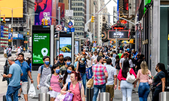People walk through Times Square in New York City on July 13, 2021. (Angela Weiss/AFP via Getty Images)