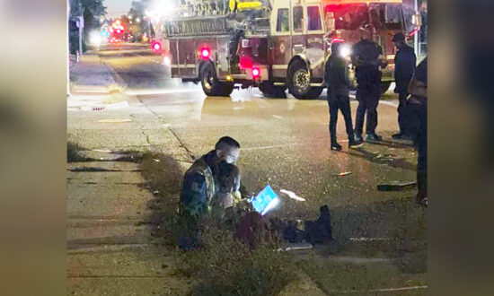 Firefighter Photographed Reading Storybook to Little Girl at Scene of Accident, Goes Viral