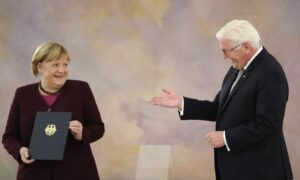 Dismissed: Germany's Merkel Becomes Caretaker Chancellor