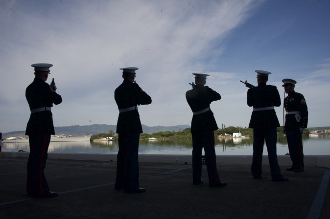 Marines fire during a Rifle Salute during a commemoration for the 75th anniversary of the Japanese attack on the naval harbor at Kilo Peir in Honolulu on Dec. 7. (Craig T. Kojima/The Star-Advertiser via AP, Pool)
