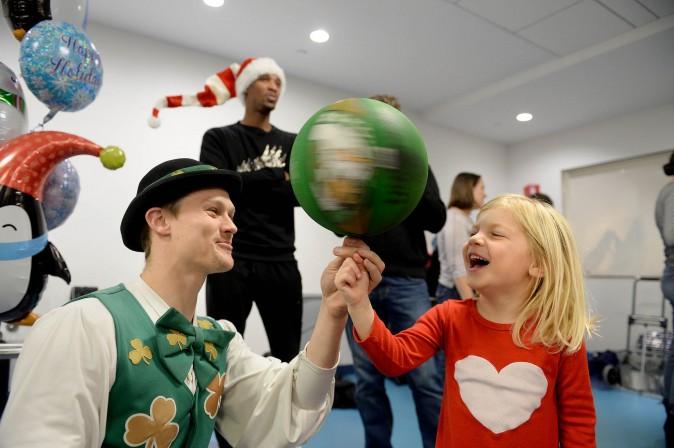 Boston Celtics mascot Lucky hangs with Grace at Boston Children's Hospital on Dec. 1. (Darren McCollester/Getty Images for Boston Children's Hospital)