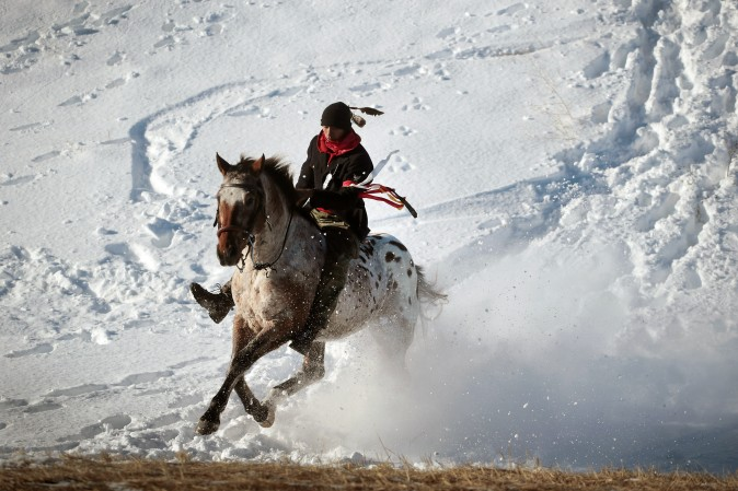An Native American activist rides down from a ridge which overlooks the Standing Rock Sioux Reservation outside Cannon Ball, N.D., on Dec. 4. Native Americans and activists from around the country have been gathering at the camp for several months trying to halt the construction of the Dakota Access Pipeline. The proposed 1,172-mile-long pipeline would transport oil from the North Dakota Bakken region through South Dakota, Iowa and into Illinois. (Scott Olson/Getty Images)