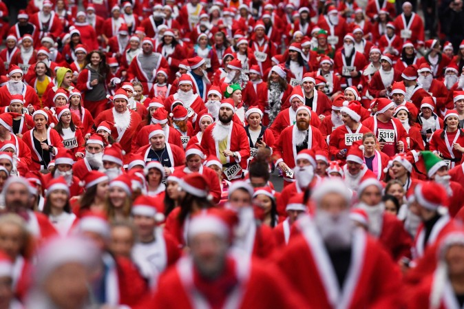 Over seven thousands people take part in the annual Santa Dash in Glasgow, Scotland, on Dec. 11, which has raised over $125,000 for charities since its inception in 2006. (Jeff J Mitchell/Getty Images)