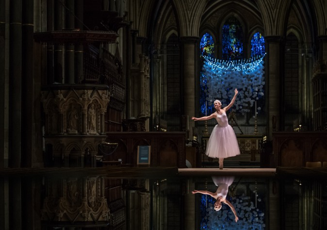 Ballerina Emily Harper dances during the dress rehearsal of A Winter's Trail, a new promenade drama being held at Salisbury Cathedral in Salisbury, England, on Dec. 16. The performance by the Hoodwink Theatre Company, which runs this weekend, is described as a playful journey through the Cathedral after dark, following a trail of winter memories in a magical story told in laughter, lights, singing and dancing, that weaves together childhood and old age. (Matt Cardy/Getty Images)