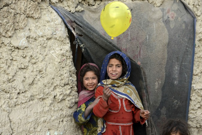 Internally displaced children play outside their temporary home at a refugee camp in Kabul, Afghanistan, on Dec. 16, 2016. (Noorullah Shirzada/AFP/Getty Images)