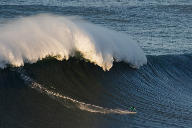 British surfer Andrew Cotton rides a big wave at Praia do Norte in Nazare, Portugal, on Dec. 17. Nazare's giant waves are increasingly attracting surfers from around the world, as it becomes part of the World Surf League Big Wave Tour. (Pablo Blazquez Dominguez/Getty Images)