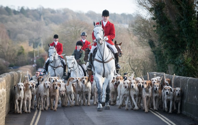 Joint Master and Huntsman Stuart Radbourn (C) leads riders for The Avon Vale Hunt's traditional Boxing Day meet in Lacock Village, England, on Dec. 26, 2016. Boxing Day is traditionally the biggest day in the fox hunt calendar. (Matt Cardy/Getty Images)