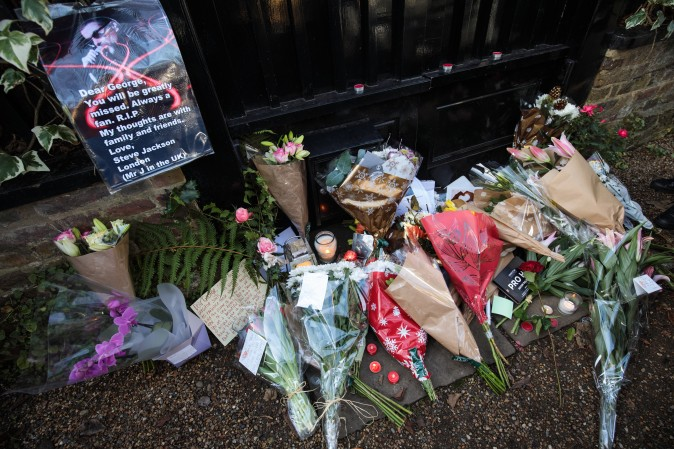 Tributes of flowers are left at the home of pop music icon George Michael in The Grove, Highgate in London, England on Dec. 26, 2016. Singer George Michael died on Christmas day in his country home in Oxfordshire at the age of 53 on Dec. 25. ( Jack Taylor/Getty Images)