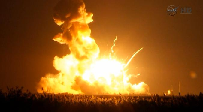 Orbital Sciences Corp.'s unmanned Antares rocket blows up over the launch complex at Wallops Island, Va., seconds after liftoff on Oct. 28, 2014. (AP Photo/NASA TV)