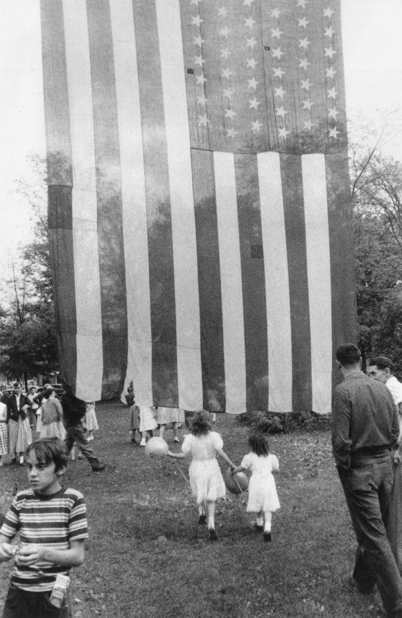 """Fourth of July — Jay, New York,"" 1955-56, by Robert Frank. Photograph in his book, ""The Americans."" 1958. (Robert Frank/PACE/MACGILL GALLERY)"