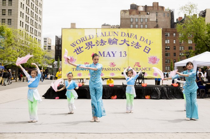 Dancers from San Cai Academy of the Arts perform at the World Falun Dafa Day event at Union Square, New York City, on May 11, 2017. (Samira Bouaou/The Epoch Times)