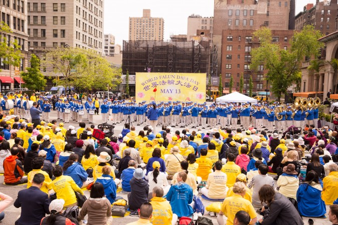The divine Land MArching Band performs during the World Falun Dafa Day event at Union Square, New York City, on May 11, 2017. (Benjamin Chasteen/The Epoch Times)