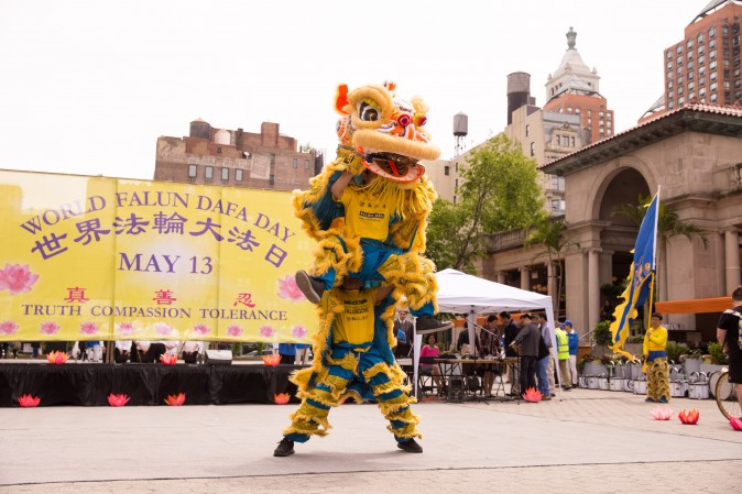 A lion dance team performs during the World Falun Dafa Day event at Union Square, New York City, on May 11, 2017. (Benjamin Chasteen/The Epoch Times)