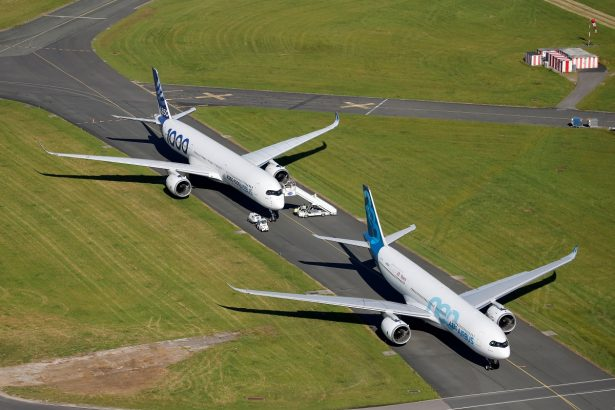 An Airbus A350-1000 and an Airbus A330 NEO are seen during the 53rd International Paris Air Show