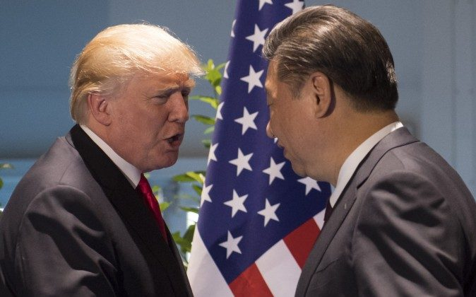 U.S. President Donald Trump and Chinese leader Xi Jinping (R) shake hands prior to a meeting on the sidelines of the G20 Summit in Hamburg, Germany on July 8, 2017. (Saul Loeb/AFP/Getty Images)