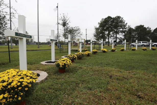 Ten crosses honoring the 10 people killed in a shooting