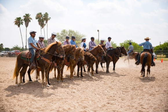 Horse patrol trainees line up for a count-off and inspection in Edinburg, Texas, on May 26. (Benjamin Chasteen/The Epoch Times)