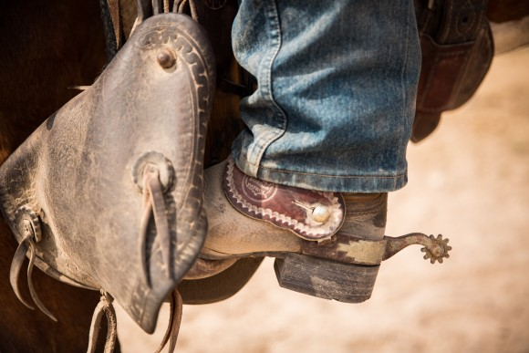 A boot and spur in a stirrup shows the Border Patrol logo. The stirrups and breast collars are made by Colorado Correctional Institute. (Benjamin Chasteen/The Epoch Times)