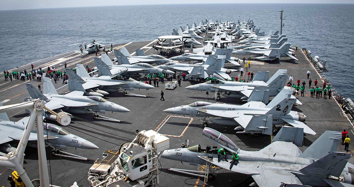 Flight deck of the U.S aircraft carrier USS Abraham Lincoln (CVN 72) is seen as sailors swip the deck for foriegn object and debris (FOD) walk-down on the flight deck of the Nimitz-class aircraft carrier USS Abraham Lincoln (CVN 72) in Arabian Sea