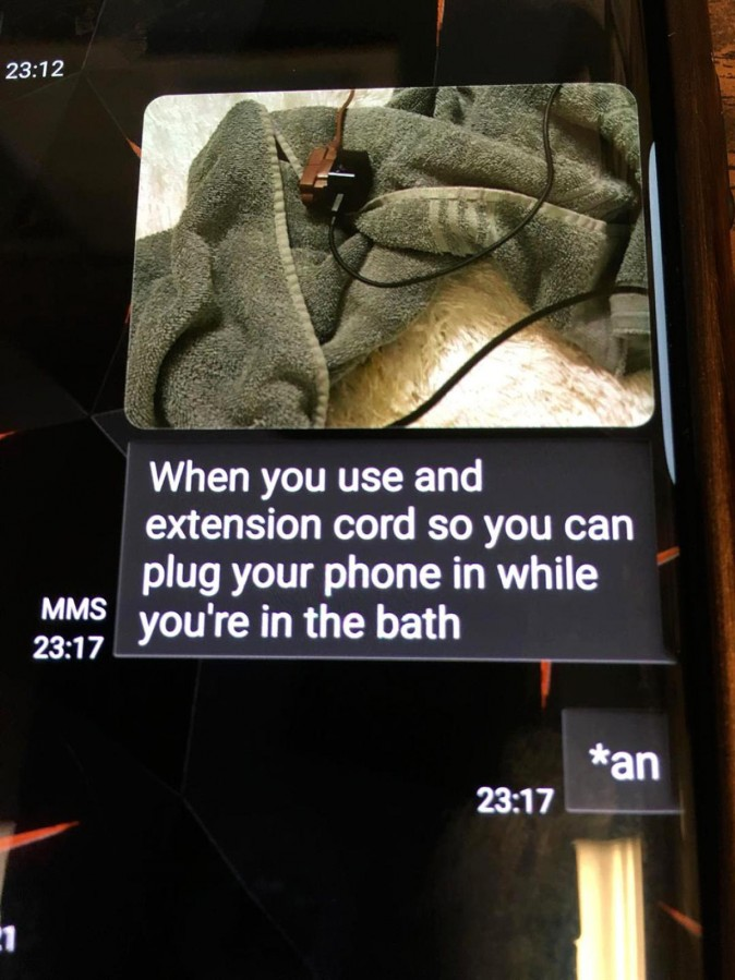 Police released the last text Coe sent, likely to a friend, showing a picture of her cell phone's charger plugged into an extension cord outside the bathtub. (LOVINGTON POLICE DEPARTMENT)