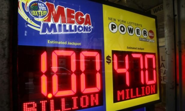 File photo of signs displaying the jackpots for Mega Millions
