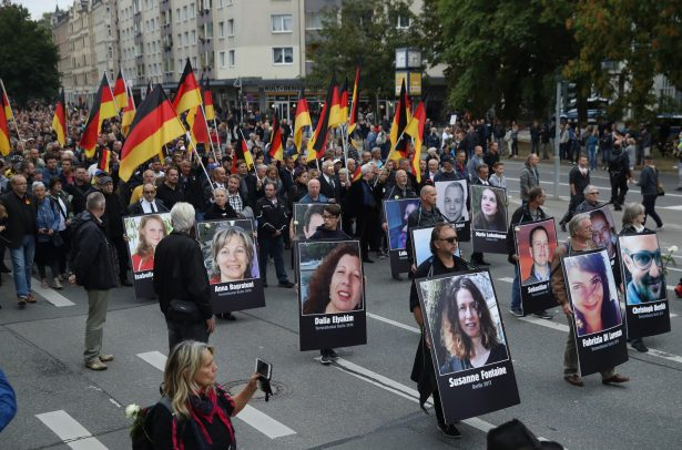 Demonstrators carry German flags