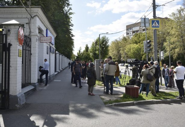 Journalists gather at a hospital
