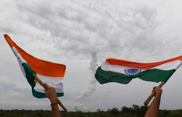 Indian residents wave Indian national flags