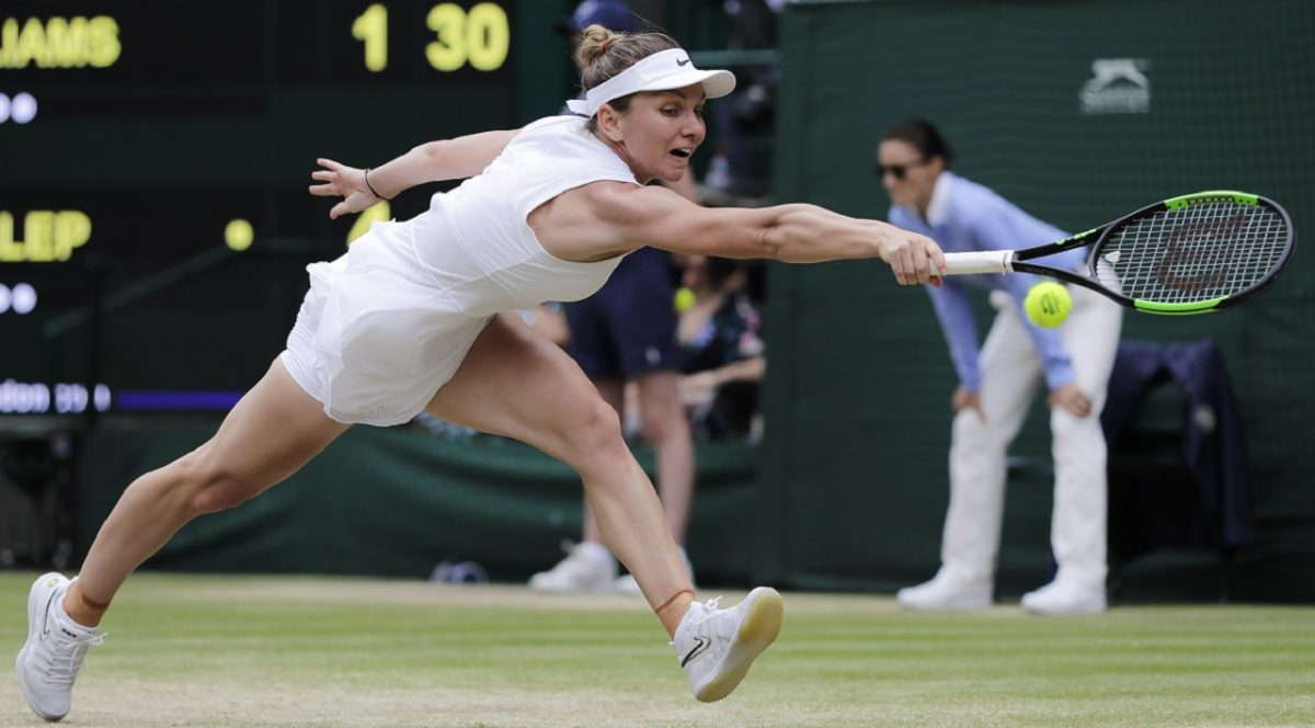 Romania's Simona Halep returns the ball to United States' Serena Williams