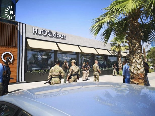 An Irbil-based Kurdish broadcaster, shows security forces at the scene of a shooting outside a restaurant in Irbil,