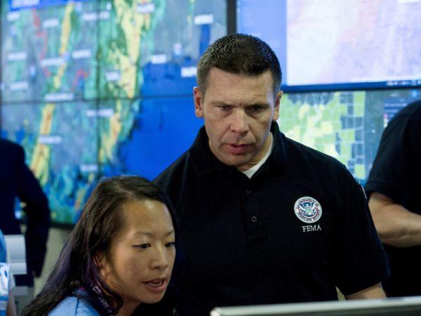 Acting Homeland Security Secretary Kevin McAleenan speaks with FEMA personnel