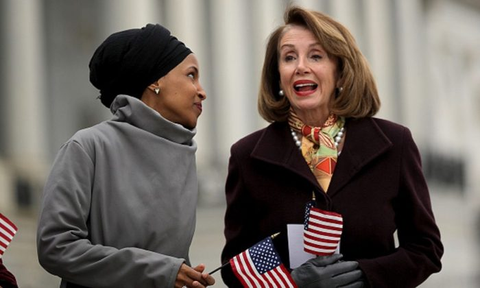 Rep. Ilhan Omar (D-MN) (L) talks with Speaker of the House Nancy Pelosi (D-CA) during a rally with fellow Democrats before voting on H.R. 1, or the People Act, on the East Steps of the U.S. Capitol in Washington on March 8, 2019. (Chip Somodevilla/Getty Images)