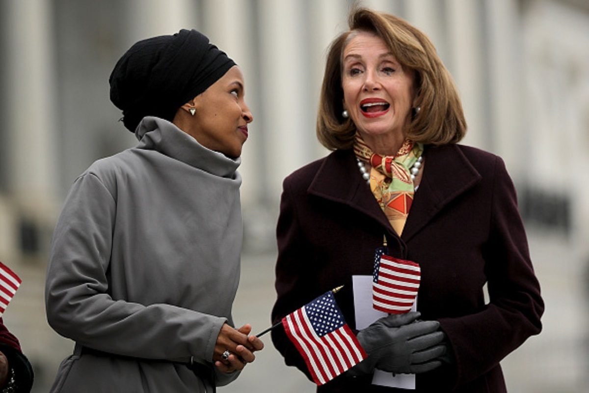 Rep. Ilhan Omar (D-MN) (L) talks with Speaker of the House Nancy Pelosi