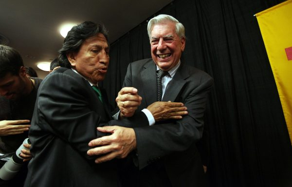 Peruvian writer Mario Vargas Llosa (R) is hugged by former Peruvian President Alejandro Toledo