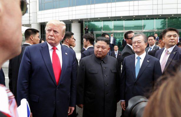 North Korean leader Kim Jong Un, U.S. President Donald Trump, and South Korean President Moon Jae-in inside the demilitarized zone